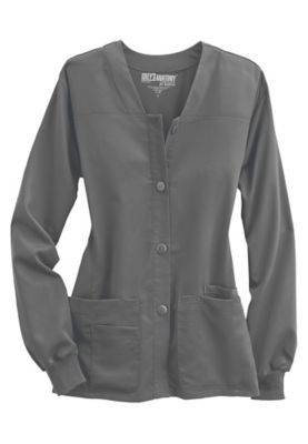 "This popular scrub jacket from the beloved Grey's Anatomy brand puts a twist on the traditional scrub jacket!  The sporty design of this cardigan style, button-front jacket adds a spark to your look!  In addition, this top includes a total of four all-important pockets, including two roomy patch pockets on the front! <ul> <li>V-neck<br> <li>Button front<br> <li>Elastic cuffs<br> <li>Two patch pockets with pen holder<br> <li>Cell phone pocket<br> <li>26"": length<br> <li>77 percent…"