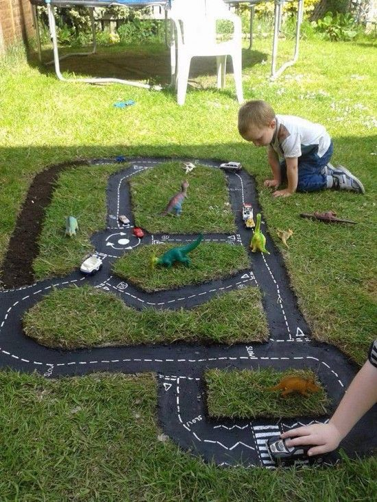 Kids Back Yard Tire Race Car Track. What a fun idea. I'm especially liking the fact that this area is being overrun by dinosaurs!!