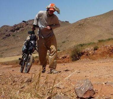 Regis Fender crossing the Sahara Desert on a 1 speed Strida folding bike