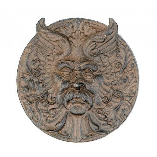 """Hanging Cast Iron Mystical Man Face Plaque Yard Tree Wall Art by HomeOffice. $21.99. 11"""" Dia. This unique and decorative wall plaque will add new dimension to your home and add a decorative flair to your home. This gorgeous cast iron wall plaque is suitable for indoor or outdoor use. It is ready to hang, a hanger is permanently installed on the back for your convenience."""