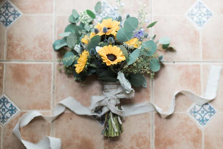 Rustic Bridal Bouquet with eucalyptus, stock, sunflowers and thistle – South Florals Weddings and Events