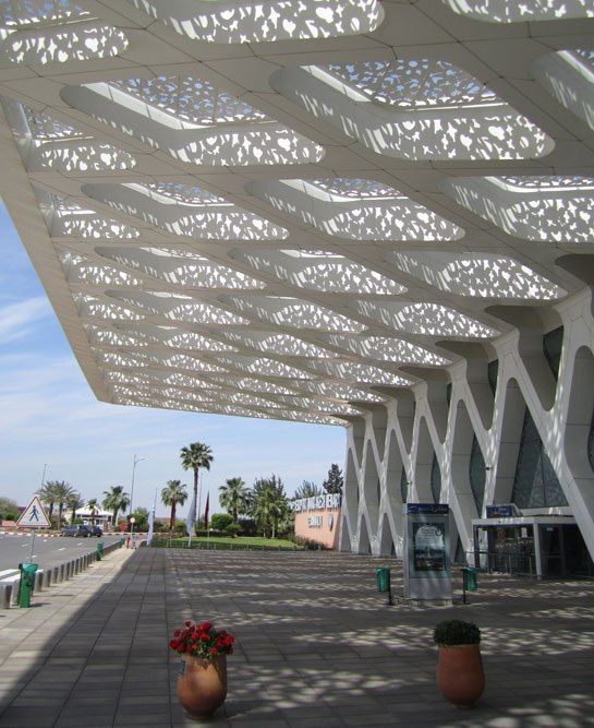 The canopy at the entrance to the grand concourse of Marrakech-Menara Airport, designed by the firms CR Architecture and E2A Architecture. (Photo: Mitchell Owens)