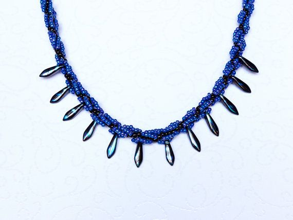 Beaded necklace with blue and black seed beads and dagger