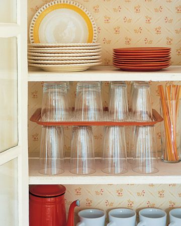 Increase cupboard space by using a serving tray as a shelf divider.