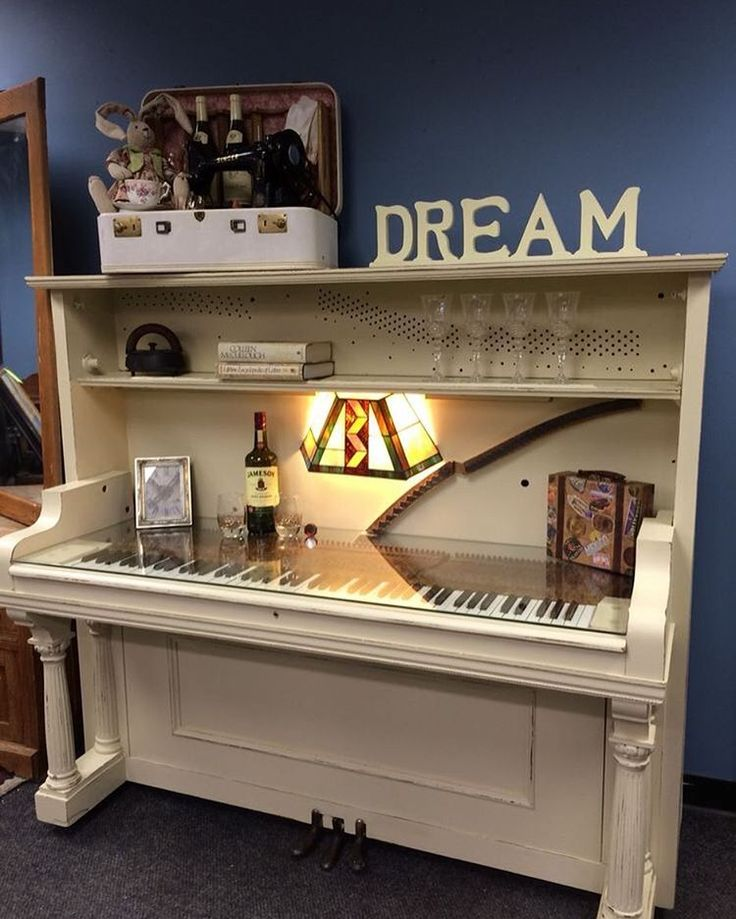 Piano turned desk/bar/bookcase. Awesome repurpose!