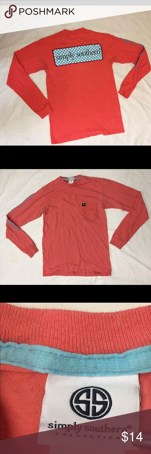"""Simply Southern Salmon Pink Long Sleeve Shirt S Good condition. Salmon pink long sleeve graphic T-Shirt. 100% Cotton. Normal cosmetic wear and wash. Tiny discoloration spots throughout and hole on the front shirt. Smoke free environment. Offers welcome! 16"""" chest lying flat 26"""" length 24"""" sleeve length  *All measurements are approximate. Images color may vary due to graphics of computer or mobile devices. Color is as stated in the description. Any flaws will be expressly noted or shown in…"""