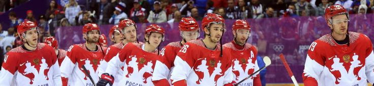 Team Russia shows its dejection after being eliminated by Finland in the quarterfinal match at the Sochi 2014 Olympic Games, February 19, 20...