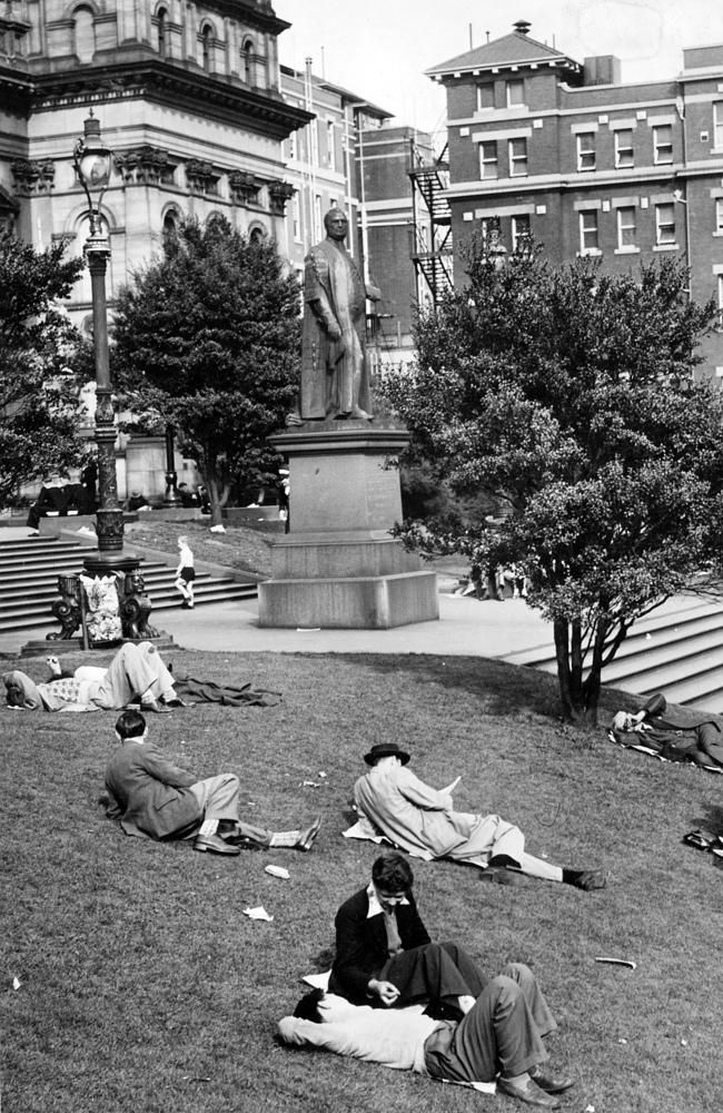 1951: People relax on the lawns outside the State Library of Victoria. Picture: Herald Sun Image Library/ARGUS