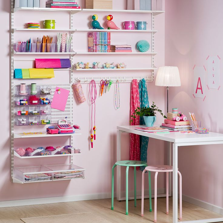 A children's hobby corner made up with Elfa shelves, wall hang and utilities like boxes and hooks.