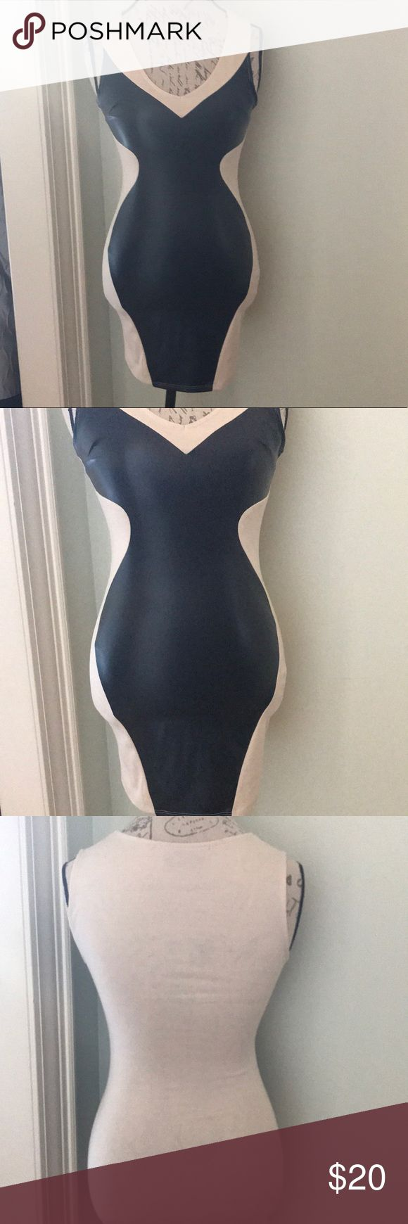 Sexy Nasty Gal Nude & Black Bodycon Dress Sz S This body con dress from Nasty Gal features black vegan leather insets on a nude cream polyester/rayon/spandex sleeveless sheath.  Excellent condition Size small Garment is somewhat opaque, but I would advise wearing a beige, nude, tan or neutral colored panty with it. Nasty Gal Dresses Mini