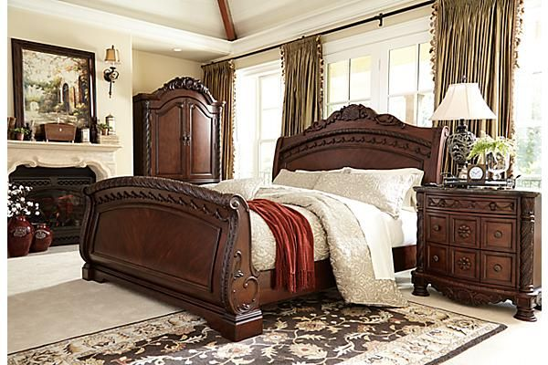 """The North Shore Sleigh Bed from Ashley Furniture HomeStore (AFHS.com). A rich traditional design and exquisite details come together to create the ultimate in the grand style of the """"North Shore"""" bedroom collection."""