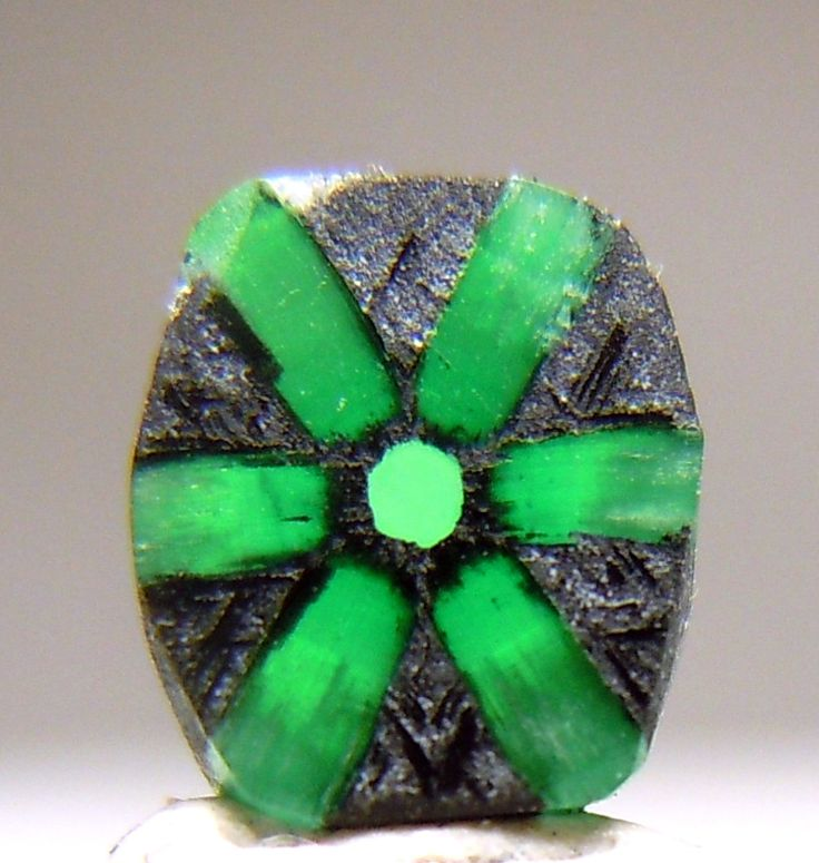 Emerald Trapiche ~  It weighs 0.42 carats and measures 6x5x1 mm.      From Muzo Mine in Colombia.