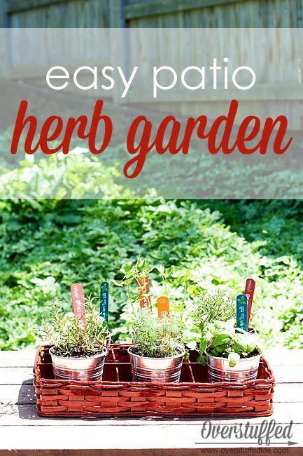 An easy patio herb garden using cheap IKEA buckets, a thrifted basket, and a little bit of spray paint