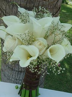 Calla Lilies, Roses, and babies breath are available all year long. The only thing I recommend is to add some color, there is such a thing as to much white