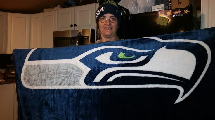 It finally arrived via #fedexground! Got my baaankie. Papa ordered it fur me. (Oh, and the hat too, that I lost shortly after the Dec 4th game against the Panthers watching live at Seattle.) Ready for kickoff today. #12sofseattle #GoSeahawks #GoRichardSherman 💙🏈💚🏈💙🏈💚🏈💙🏈💚🏈💙