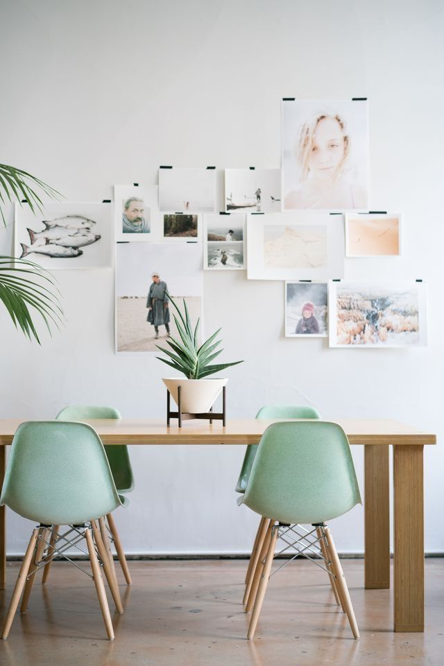 pastel colours and mint eames chairs in the dining room