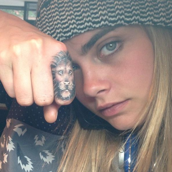 Cara Delevingne's Lion Finger - The 50 Most Stylish Celebrity Tattoos - Photos