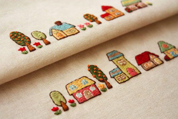 カラフルな家の刺繍です。 この刺繍は、もう何を作るか決まっていたので、そのサイズに合わせて、図案を考えました。 色は、刺繍をしながら合わせたのですが、ちょ…