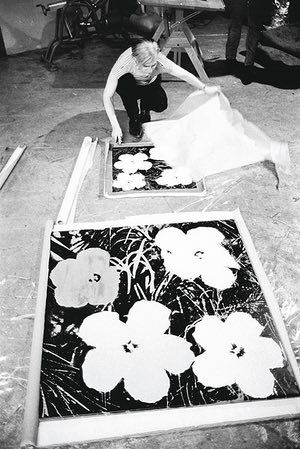 Andy Warhol silk-screening Flowers, first shown at Leo Castelli Gallery (1964)