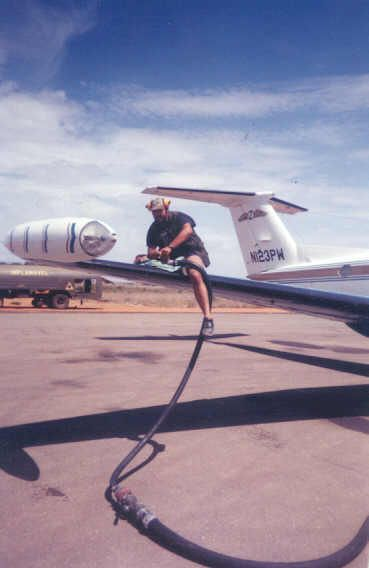 EXECUTIVE OUTCOMES 1993. me refueling N123PW belonging to Crause Steyl.