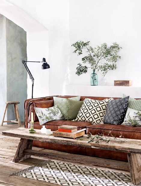 H&M Living Room--I like the geometric patterns, lighting and reclaimed wood table