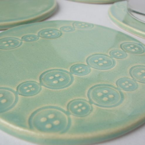 ceramic coaster with button imprint