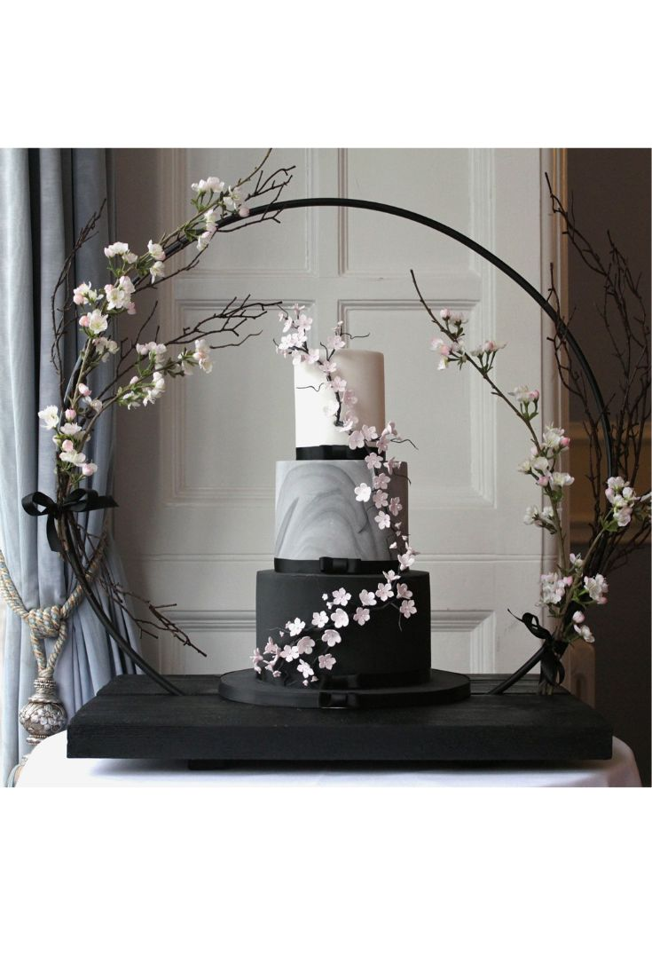 Modern black and marble wedding cake with sugar cherry blossoms. Made by Debbie Gillespie Cake Design, supplying wedding cakes to Yorkshire, Cheshire and Manchester #modernweddingcakes #weddingcakesyorkshire #blackweddingcakes #cherryblossomweddingcake #weddingcakes