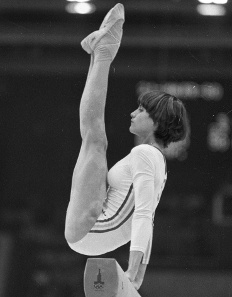 Nadia Comaneci took up the sport of gymnastics aged six, becoming one of the first students at a school founded by coach Béla Károlyi. In 1975, 13-year-old Comaneci won gold in every event at the European Championships except the floor exercise.