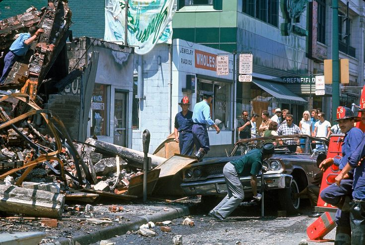 Remembering the Detroit Riots of 1967: Firemen and civilians starting to clear debris.