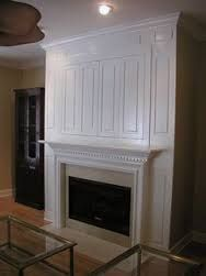 Image result for concealed tv above fireplace