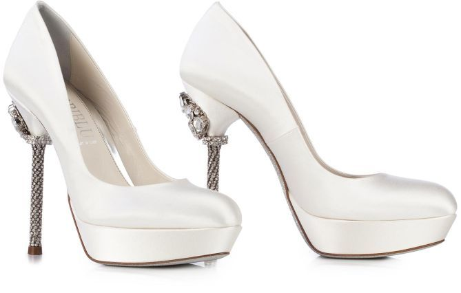 Ivory satin jewel shoe with stiletto heel and platform. Enchanting the sparkling of SWAROVSKI ELEMENTS set along the heel. A gorgeous column with brilliant crystals and stones able to illuminate and make unique your special occasion outfits.
