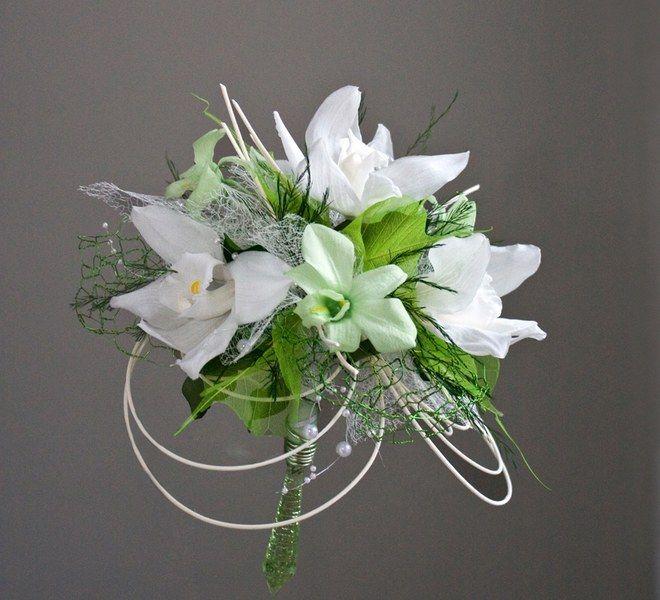 Bouquet de mariée Fleurs d'un nouveau monde - Modèle DéliceBouquet composé de lys verts et blancs, perles, feuillages© Fleurs...
