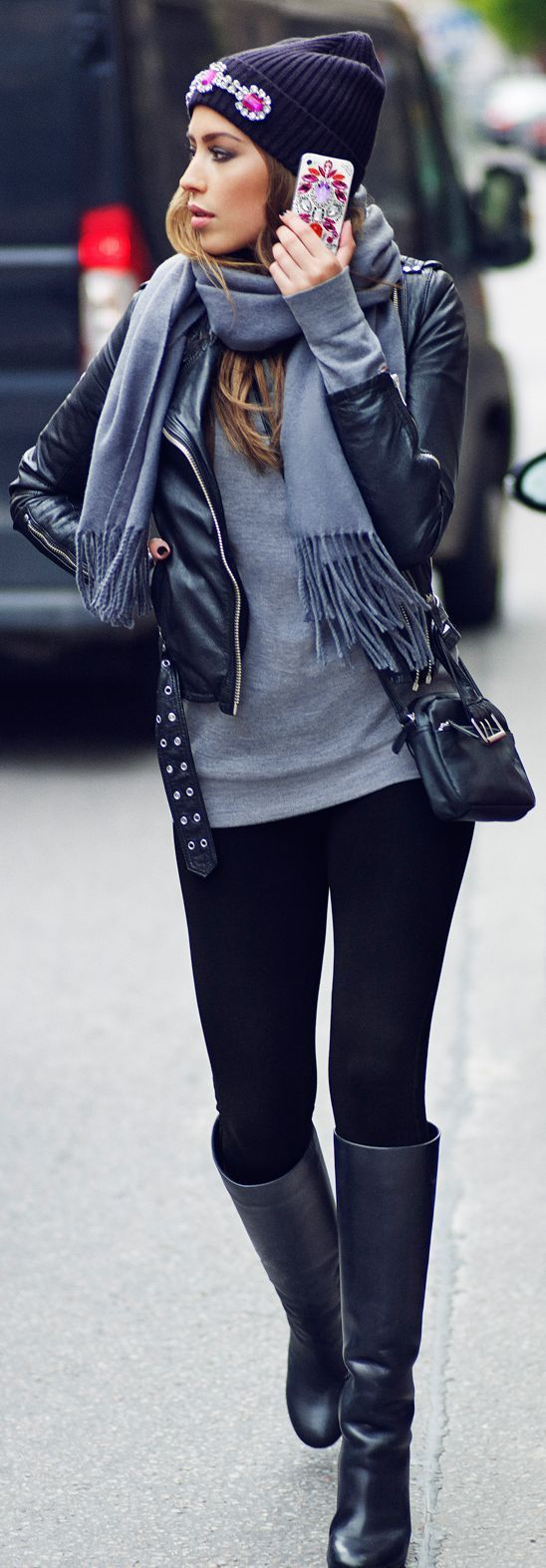 A black leather moto jacket and black leggings are a great outfit formula to have in your arsenal. Polish off the ensemble with black leather knee high boots.  Shop this look for $93:  http://lookastic.com/women/looks/beanie-scarf-long-sleeve-t-shirt-crossbody-bag-leggings-knee-high-boots-biker-jacket/7616  — Black Embellished Beanie  — Grey Scarf  — Grey Long Sleeve T-shirt  — Black Leather Crossbody Bag  — Black Leggings  — Black Leather Knee High Boots  — Black Leather Biker Jacket