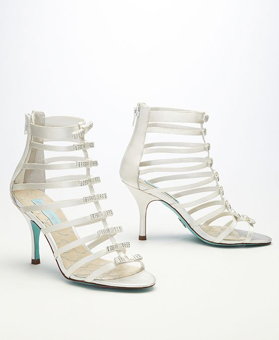 A fierce caged sandal with girly bow details? Hello dream shoe!