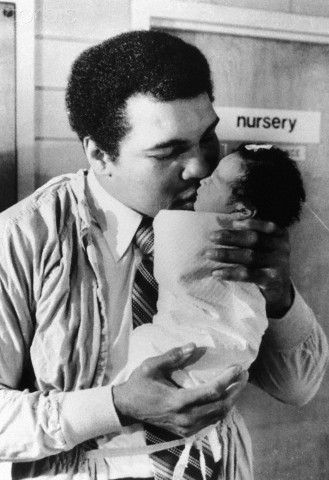 Muhammad Ali as a Baby | Muhammad Ali Kissing His Baby Daughter - U1920703 - Rights Managed ...