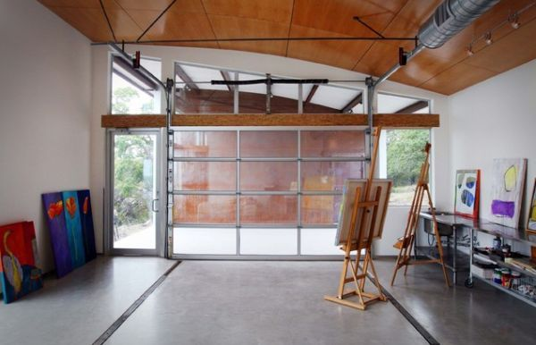 Garage as Art Studio: How To Convert A Garage Into A Living Space. The glass #garagedoor lets in tons of natural light.