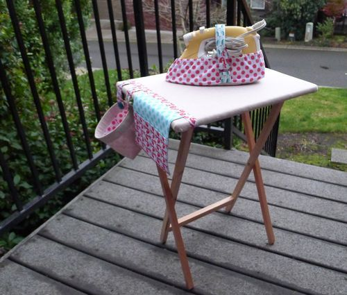 By far the best take on the portable ironing table I have ever seen. Tool caddy, scrap catcher, heat-resistant iron caddy and even a slip case for the whole thing to keep it from flopping around when it is being carried or stored. I absolutely need to make this.