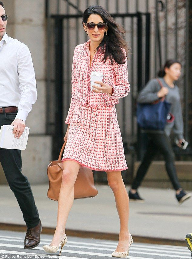 Pretty in pink: Amal Clooney stunned in a conservative chic ensemble as she stepped out fo...