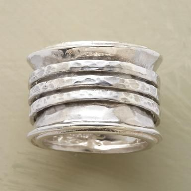 """I love the jewelry on Sundance.. MY STYLE.... Three hammered bands trapped within the confines of our ring make beautiful music as they shift this way and that with every movement. Handcrafted of sterling silver exclusively for us. Whole sizes 5 to 9. Approx. 5/8""""W. This ring is licensed under U.S. Patent Nos. 6,497,117 and 6,395,732."""
