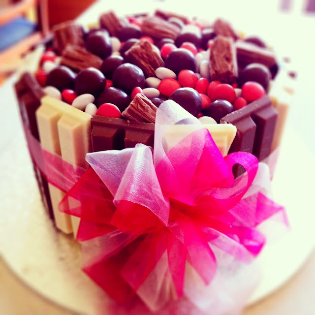 Chocolate lolly cake ... who wants to be the lucky one to get this?? have a mini cupcakes! would be so cute cause you get your own individuals