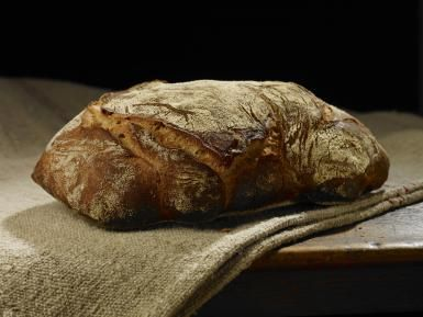 French Country Sourdough Artisan Bread - Steve Lupton / Getty Images
