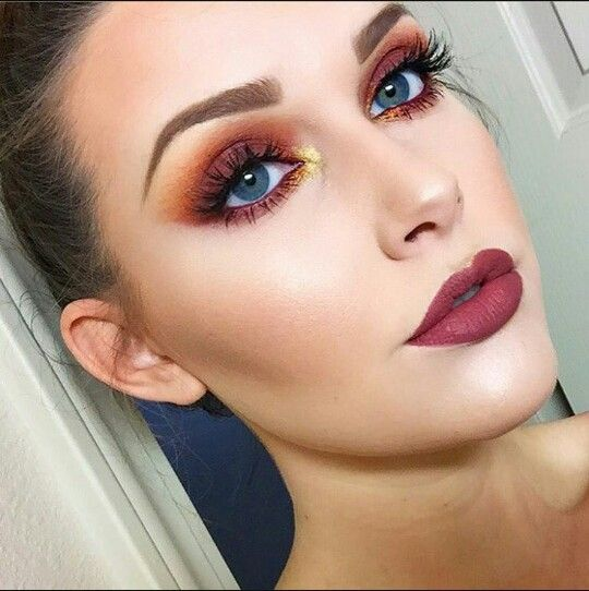 Burnt orange eyeshadow with cranberry lips