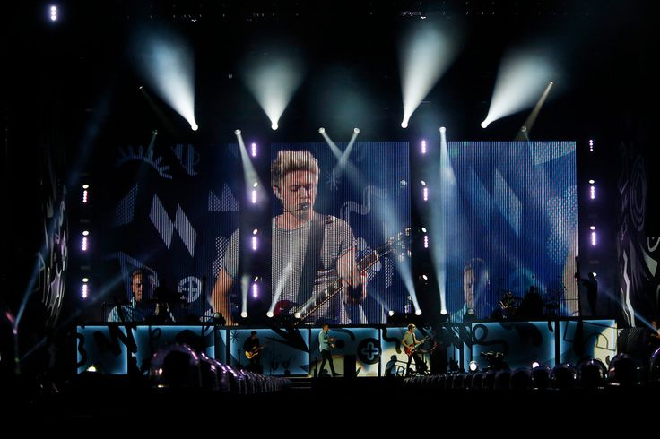 . Niall Horan, on guitar, is projected on the screen as he performs with One Direction at Levi\'s Stadium in Santa Clara, Calif., on Saturday, July 11, 2015. (Jim Gensheimer/Bay Area News Group)