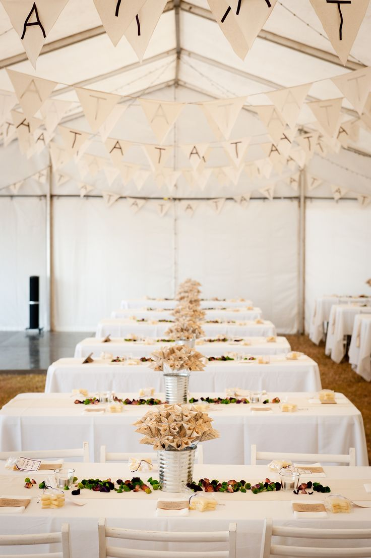 Rustic wedding tables. Handmade paper flowers. Coloured, scented wood curls. Dark purple and apple green. Calico bunting.