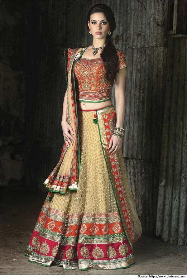 The designer orange colored blouse is ellaborate, and so is the #dupatta.  #bridallehengas #weddinglehengas