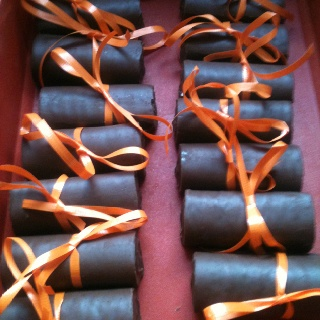 Easy graduation treat!  Ho-Hos wrapped in ribbon of the school's color:)