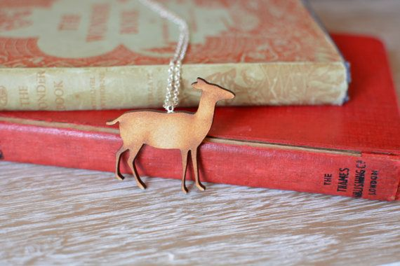 Wooden Deer Necklace. A delightful handmade deer necklace, with silver plated chain and findings.   https://www.etsy.com/uk/listing/220559078/wooden-deer-necklace-woodland-animal?ref=shop_home_active_7