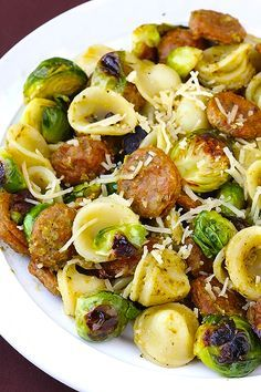 pesto pasta with chicken sausage and roasted brussels sprouts.