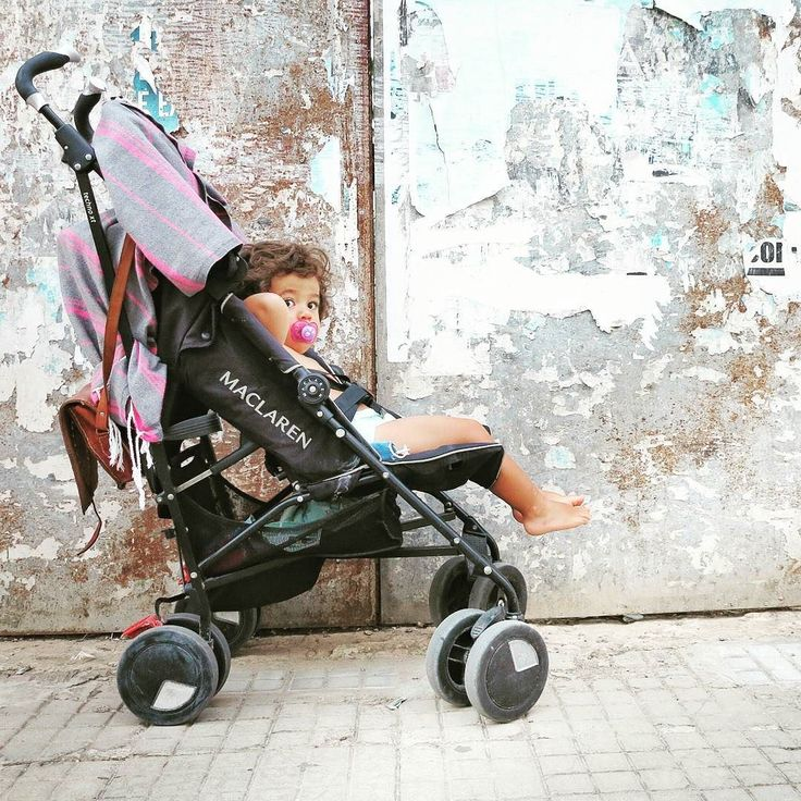 Scuzzy Spanish walls and a knackered (but trusty) travel buggy never looked so good together #bikinisandbibs #maclarenbaby #travelwithkids #throwbackthursday by bikinisandbibs