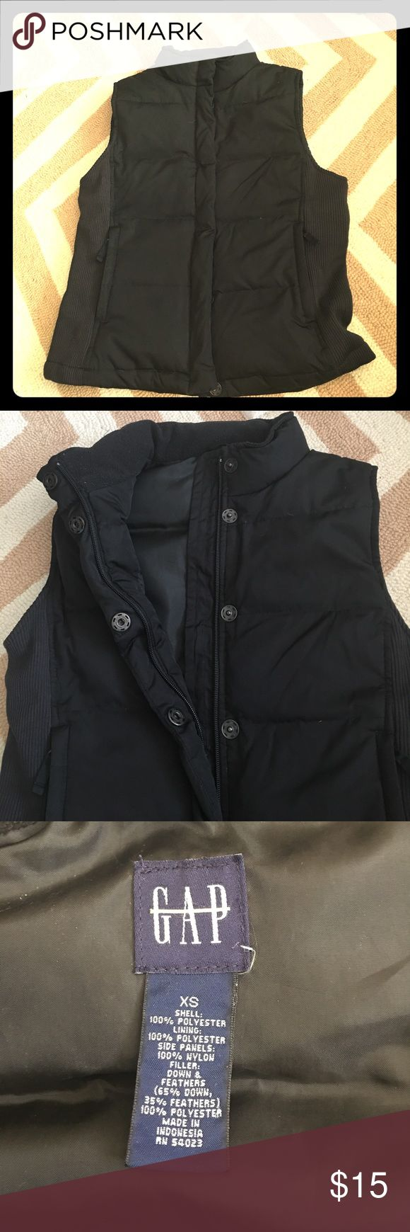 Puffer vest Puffer vest with zip and button front closure; zippered pockets; ribbed side panels, fleece lined collar. Perfect for fall, so comfortable for everyday. Great condition - no rips or stains. Size XS but runs big IMO. Bought from Gap outlet hence tag is crossed out GAP Jackets & Coats Puffers
